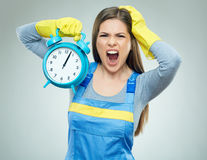 Shocking woman builder holding alarm clock. Stock Images