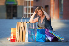 Shocking woman among shopping bags Stock Photography