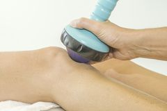 Shockwave treatment on knee Stock Photo