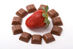 Shocolate around strawberry. A photo of little chocolate bars around strawberry Royalty Free Stock Images