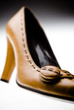 Shoe. Woman shoe - italian style -selective focus on button - unusual angle Royalty Free Stock Photos