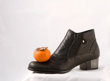 Shoe. Woman fashion boot and fruit Stock Photos