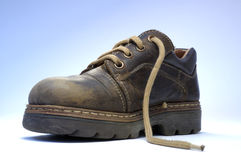 Shoe. One children's old shoe with shoelace Royalty Free Stock Images