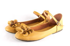 Shoe. A pair of yellow shoes on white background Stock Photo