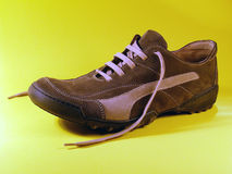 Shoe. Brown shoe over yellow Royalty Free Stock Photos