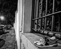 Shoe abandoned. Street night downtown Stock Photo
