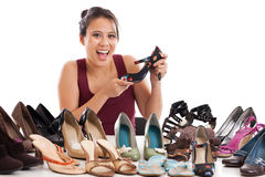 Shoe addict. Happy Asian woman showing off her shoe collection isolated on white Royalty Free Stock Image