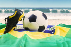 Shoe, ball, and flag at beach Royalty Free Stock Photo