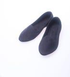 Shoe. black colour fashion woman shoes on a background. Stock Photos