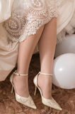 Shoe of the bride. Royalty Free Stock Photos