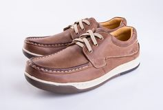 Shoe or brown color men's shoes on a background. Shoe or brown color men's shoes on a background Stock Photo