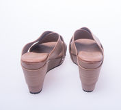Shoe. Brown colour fashion woman shoes on a background. Royalty Free Stock Photography