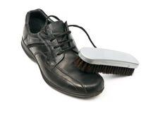 Shoe and brush Stock Photo