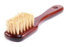 Shoe brush. Varnished wooden shoe brush on a white background Royalty Free Stock Photos