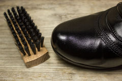 Shoe brush and black shoes Royalty Free Stock Photos