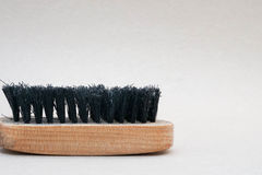 Shoe brush. Close up old shoe brush in the left of frame Stock Photo