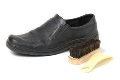 Shoe brush and shoe Stock Images