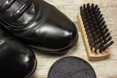 Shoe brush, Shoe Polish and black shoes Stock Image
