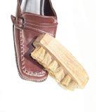Shoe brush on shoes Royalty Free Stock Photo