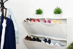 Shoe cabinet with footwear in room. royalty free stock photo