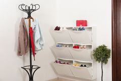Shoe cabinet with footwear in room. Storage ideas royalty free stock photos