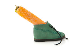 Shoe with carrot Stock Photos