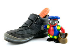 A shoe with carrot and black piet Royalty Free Stock Photography