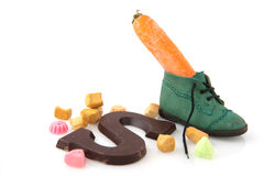 Shoe with carrot and candy Stock Photos