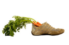 Shoe with carrots Royalty Free Stock Image