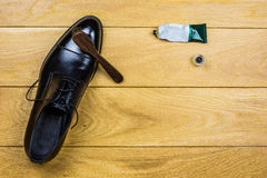 Shoe cleaning set on wooden background Stock Photos