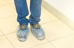 Shoe covers on shoes, on the floor. Shoe covers on shoes, on the floor Stock Images