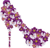 Shoe decorated with flowers. Stock Photo