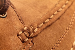 Shoe Detail. Close-up of stitching in suede leather shoe royalty free stock images