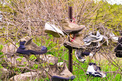 Shoe Fence B. An fence in the country where people hang their shoes royalty free stock images