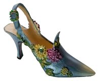 Shoe-Flowers (miniatures) Series. Bluefin shoes decorated with flowers on a white background Royalty Free Stock Image