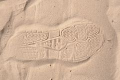 Shoe foot print on sand Royalty Free Stock Photos