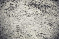 Shoe footprint imprints on ground. Famer Royalty Free Stock Photo