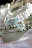 Shoe Garter. A brides silver shoes and white garter Stock Photo