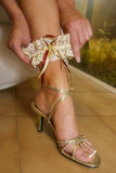 Shoe and golden garter. Stock Photos