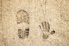 Shoe And Hand Print In Cement Royalty Free Stock Image