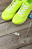 Shoe and headphones Royalty Free Stock Photo