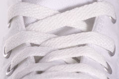 Shoe lace. Close up to a white sport style shoe Stock Images