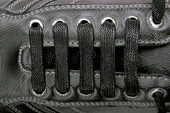 Shoe laces. Abstract black shoe laces closeup royalty free stock photo