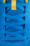 Shoe laces of a blue new sneakers. Royalty Free Stock Photos