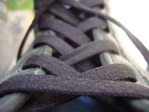 Shoe laces. Leather shoe with black laces close view stock image