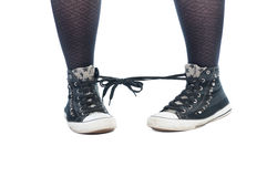 Shoe laces tied together prank. Isolated on white background Stock Images
