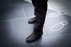 Shoe and leg of a businessman Royalty Free Stock Photos
