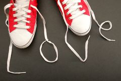 Shoe love. The shoelaces of some red sneakers forming the word love Royalty Free Stock Photo