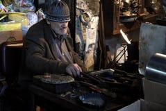Shoe maker Stock Images