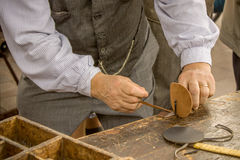 The shoe-maker. Old traditional crafts Stock Photo